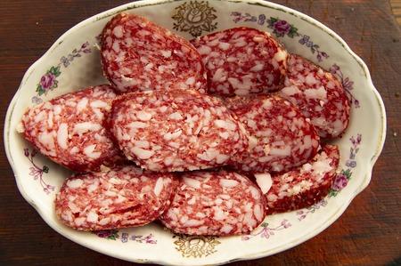 Sliced sausage - serving meals. Background.
