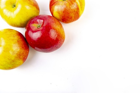 Red and yellow apples isolated on white background