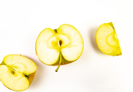 Halved apple on a white background. Fruits.