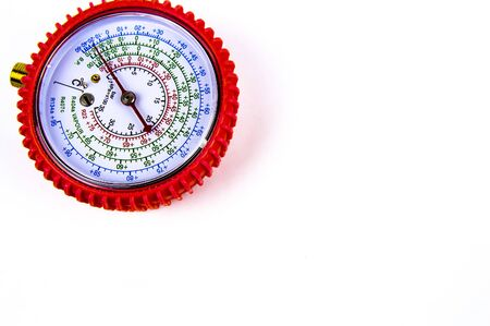 The manometer measuring gas pressure for repair of refrigerators, conditioners. Free space for text. Isolated on white background. Stock Photo