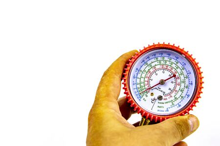 Manometer measuring the pressure of gas for the repair of refrigerators, air conditioners in hand. Free space for text. Isolated on white background. Stock Photo