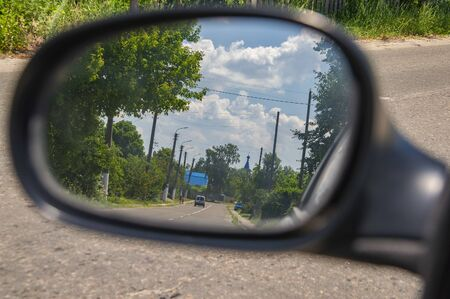 Natural landscape - a reflection in the mirror of the car. Background.