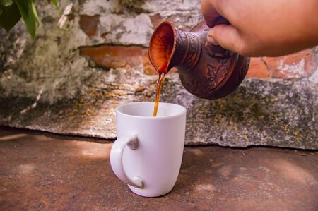 Clay Turk for coffee and a white cup on a brick wall background. Background.