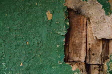Texture of a green broken wooden wall. Background. Banco de Imagens