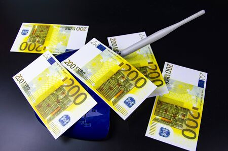 Money on the Internet router - Internet earnings. Euro. Background. Zdjęcie Seryjne