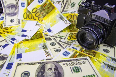 The camera is on the money - online earnings on the photo. Euro, dollar. Background.