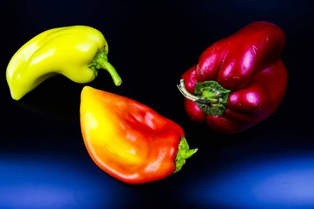 Garden vegetable sweet pepper on a black background. Food photo. Background.