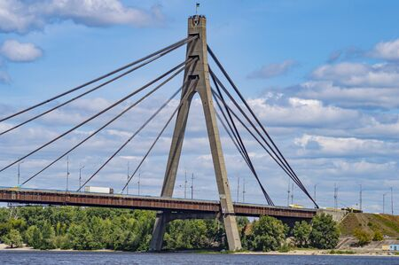 A bridge across the river with stretching cables. North bridge in Kiev. Dnepr River. Ukraine.