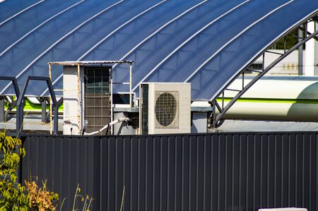 Air conditioning on the roof of an industrial building. Technology. Repairs. Stock Photo