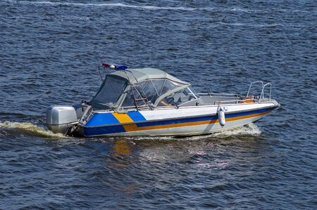 Water police boat with a siren. Public order protection. Stock Photo