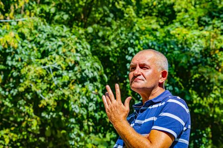 Portrait of a gray-haired middle-aged man. Facial Expressions. Grimace. The mature age of a person. Фото со стока