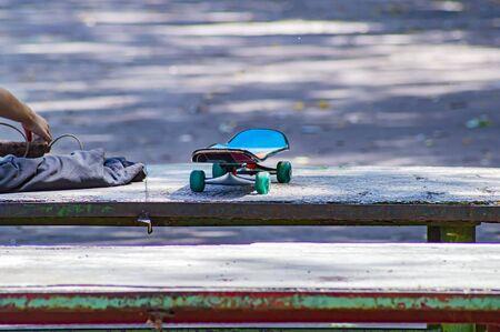 Skate board lies on the table. Sport. Leisure activities. Standard-Bild - 129488577