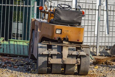 Machine for paving the streets of the city. Technology. Background image.