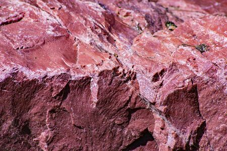 The texture of red granite stone. Place for text. Background image.