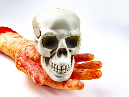 The skull of a man in a bloody hand. Halloween