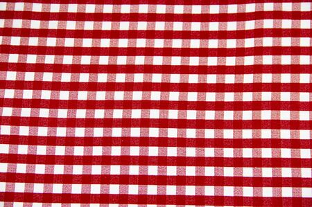 Texture of white fabric in a red cell. Background image.
