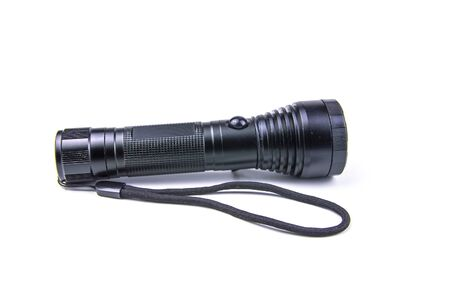 Linterna negra sobre un fondo blanco. Tecnologías. Imagen de fondo. Lugar para el texto.