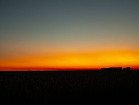 Red sunny sunset on the horizon. Natural background. Stock Photo