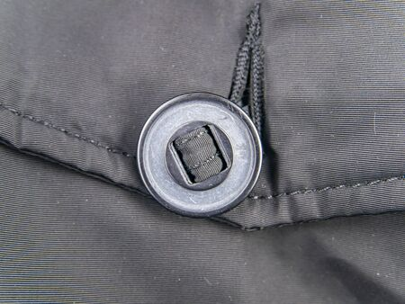 A large button on clothes. Clothing. 스톡 콘텐츠