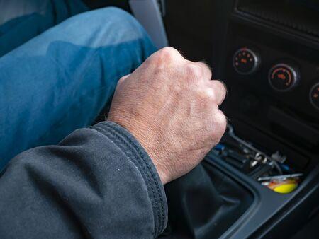 Driver's hand on gear knob. Transport.