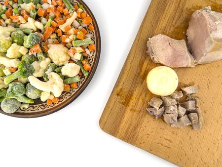Sliced vegetables and meat on a white background. Food photo. Cooking food.
