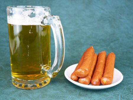 A mug of beer and Bavarian sausages. Food and drinks. Place for text. Reklamní fotografie