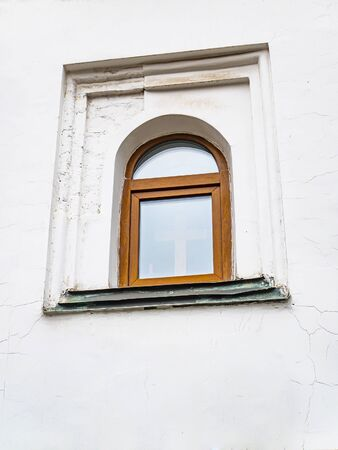 Wooden window in a white wall. Background. Place for text.