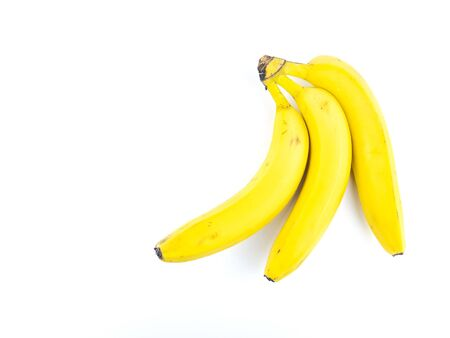 Yellow bananas on a white background. Place for text. Stok Fotoğraf