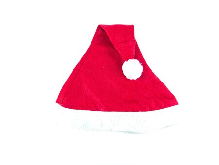 Red santa claus hat on a white background with place for text. Greeting card. Christmas. New Year's holidays. Background image.