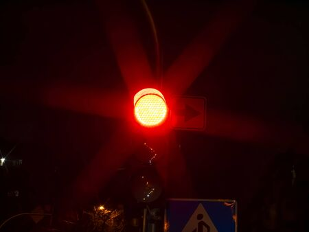 Red traffic light for cars at night. Traffic Laws. Background image. Place for text.