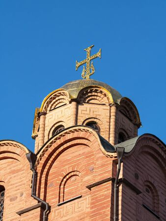 Cross on the dome of an Orthodox church in Kiev. Religion. Easter. Christmas. Place for text.