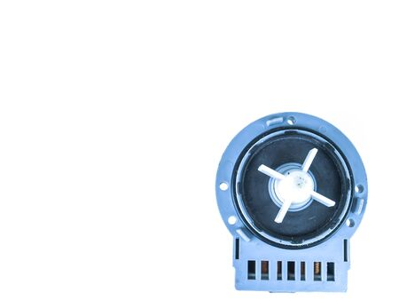 Motor pump with impeller of a washing machine on a white background. Repair of washing machines. Repair of dishwashers. The spare part. Appliances. Place for text.