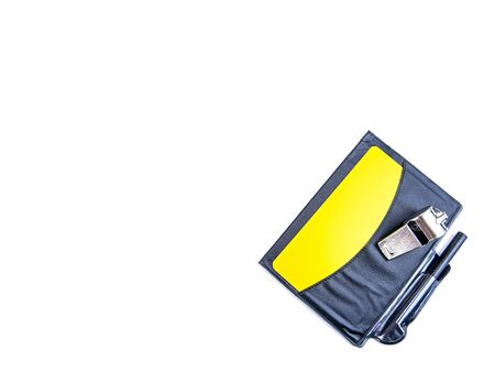 Yellow card and whistle of a football referee on a white background. Football. Championship. World. Europe. Referee. Place for text.
