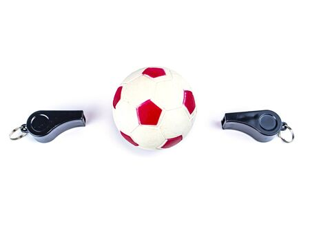 Soccer ball and whistle of a soccer referee on a white background. Football. Championship. World. Europe. Referee. Place for text. Archivio Fotografico