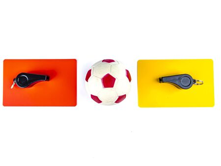 Soccer ball red and yellow cards with the whistle of a soccer referee on a white background. Football. Championship. World. Europe. Referee. Place for text.