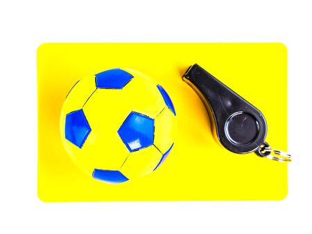 Soccer ball and yellow card with the whistle of a soccer referee on a white background. Football. Championship. World. Europe. Referee. Place for text. Stock Photo