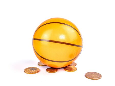 Basketball ball with coins on a white background. Sport. Tote. Background image. Place for text. Banque d'images