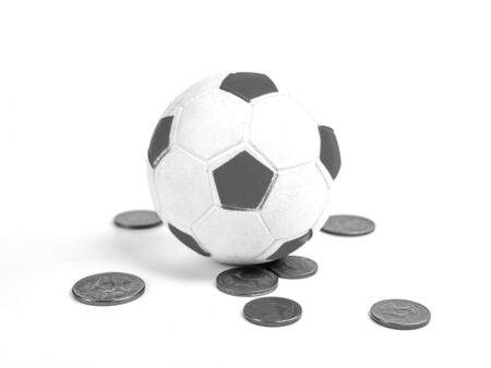 Soccer ball and money on a white background.