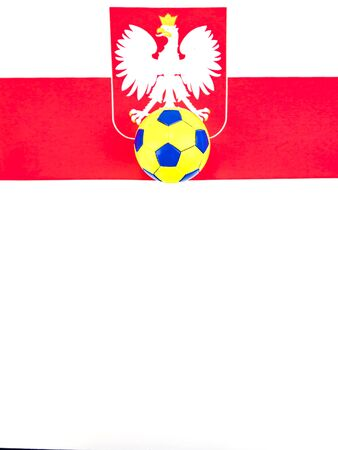 Soccer ball on the background of the flag of Poland. Championship. World. Europe. Place for text.