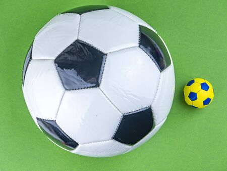 Soccer ball on a green background. Sports Championship. Europe. World. Free space for text. Background image.