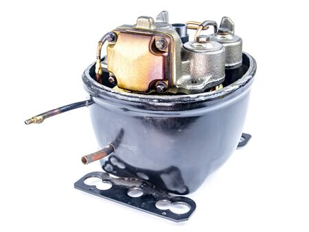 Compressor for repairing refrigerators on a white background. Repair of refrigerators. Equipment. Valve. Piston. Place for text. Spare parts for the refrigerator.