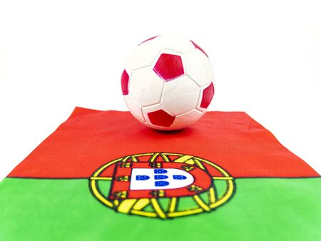 Portugal flag and soccer ball on a white background. Football. Championship. World. Earopa. Sport. Place for text.