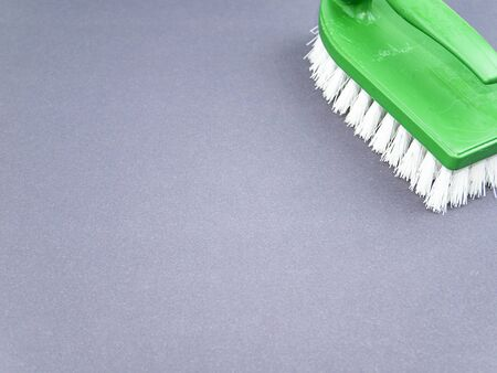 Clothes brush with white bristles on a gray background. Tool. Place for text. Background image. Stock fotó