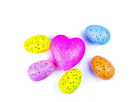 Easter eggs and heart symbol on a white background. Place for text. Template. Background image. Religious holiday. The culture.