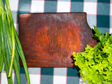 Kitchen cutting board and vegetables for salad. Recipe. Cooking food. Food photo. Home kitchen. Menu. Place for text. Template. Place of advertising. Background image. Poster. Archivio Fotografico