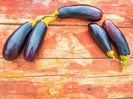 Blue eggplant vegetables on a wooden table.