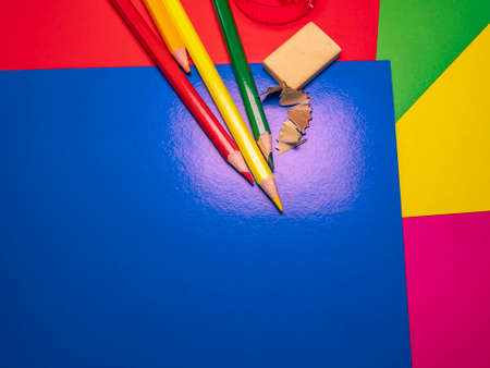 Sharpening a pencil for drawing with a sharpener. School drawing lesson. Eraser. Place for your text. Template. Background image. Poster. Sheets of colored paper.