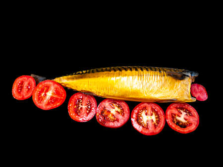 Smoked fish mackerel and tomatoes on a black background. Salted mackerel fish. Canned food. Food photo. Recipe. Menu of dishes. Vegetarian food. Home kitchen. Fishing. Background image.