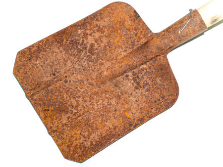 Old iron shovel for digging on a white background.