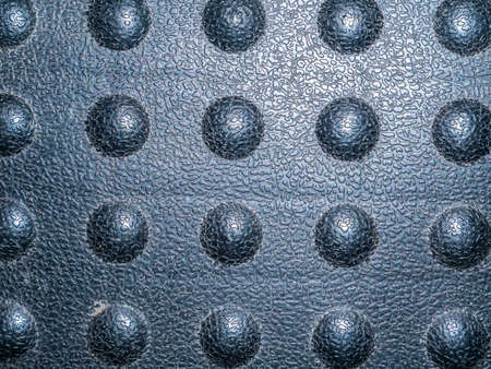 Texture of a black plastic surface with bulges. Black plastic. Background image. Place for your text. Website page background.